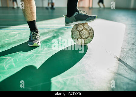 Close-up of indoor soccer player with ball - Stock Photo