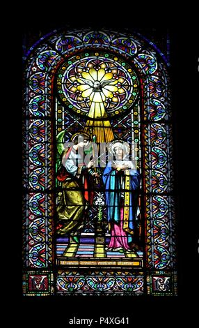 Stained glass window depicting the Annunciation. Montserrat Abbey. Catalonia. Spain. - Stock Photo