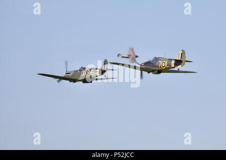 1941 Hawker Sea Hurricane flying with the newly restored Supermarine Spitfire VC AR501 at the Fly Navy airshow at Old Warden on the 3rd June  2018 - Stock Photo