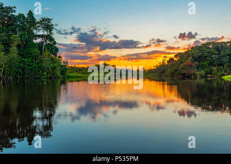 Reflection of a sunset in the Amazon Rainforest Basin. The countries of Brazil, Bolivia, Colombia, Ecuador, Peru, Venezuela, Guyana and Suriname. - Stock Photo