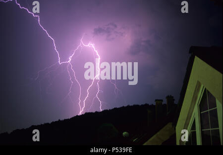 A bolt of lightning over the City of Budapest, Hungary, during a severe summer thunderstorm - Stock Photo