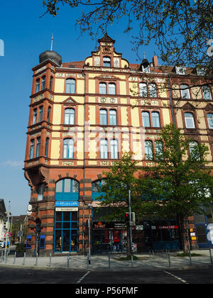Majestic building in traditional red brick architectural style in Hanover, Germany - Stock Photo