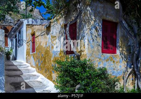 Plaka, Athens / Greece. Old traditional colorful houses in Anafiotika - Plaka neighborhood beneath the Acropolis rock of Athens city - Stock Photo