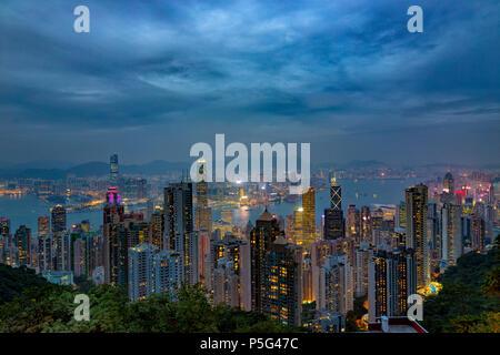 HONG KONG - NOV 6: Neon lights of Hong Kong on November, 6, 2017. Evening skyline from The Peak - Stock Photo