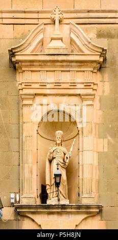 Statue of Jesus in an apse recess outside Gasri church, Gozo, Malta. - Stock Photo