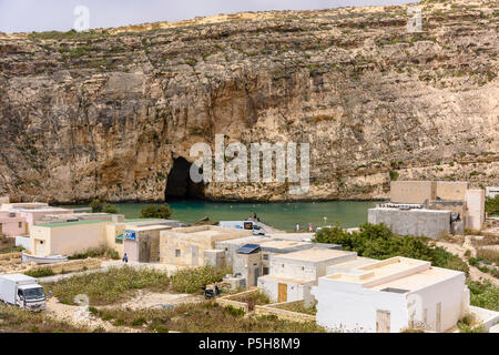 Dwerja, the inland sea, Gozo, Malta.  The cave joins with the Mediterranean sea on the other side of the cliff. - Stock Photo