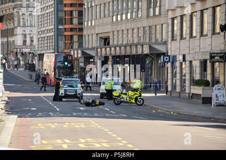 Blackfriars, London. 27th June 2018. Police and emergency services stand by a motorbike on Blackfriars road after an incident involving a pedestrian and the motorbike, London, UK Credit: RZ_Images/Alamy Live News - Stock Photo