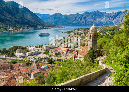 Scenic panoramic view of the historic town of Kotor with famous Bay of Kotor on a beautiful sunny day with blue sky and clouds, Montenegro, Balkans - Stock Photo