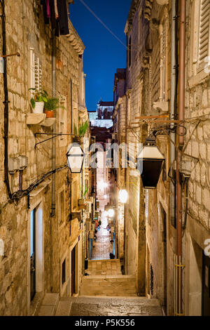 Classic vertical view of small alleyway in the old town of Dubrovnik, in beautiful morning twilight before sunrise at dawn in summer, Dalmatia, Croati - Stock Photo