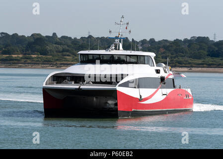A passeger cataraman ferry underway over water route. - Stock Photo