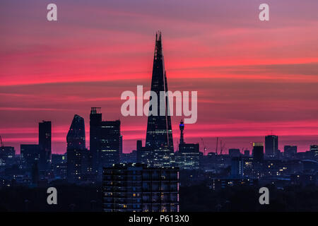 London, UK. 27th June, 2018. UK Weather: Dramatic colourful evening light over the city including The Shard skyscraper building. Credit: Guy Corbishley/Alamy Live News - Stock Photo