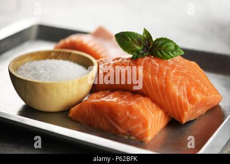 Fillet of salmon fish on metal plate closeup - Stock Photo