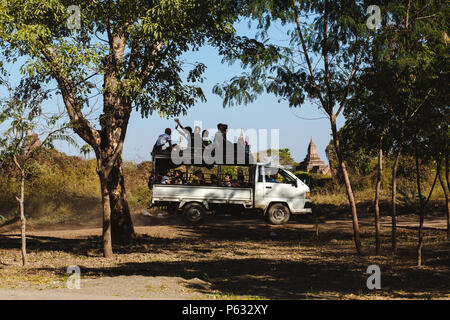 Bagan, Myanmar - FEB 21th 2014: People with the local bus on rural road - Stock Photo