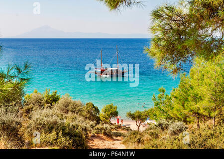 POTOS, THASSOS GREECE, 03 SEPTEMBER 2016 Small beach Potos in Greek island Thassos, with boat on sea on 03 september on Thassos - Stock Photo