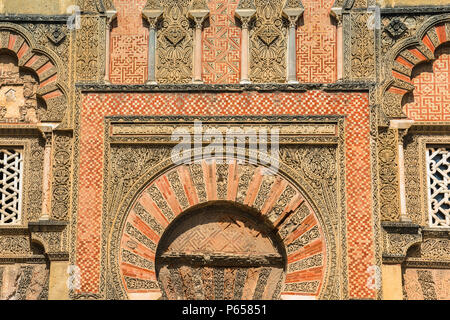Spain Moorish architecture, detail of a Moorish decorated doorway set within the outer wall of the Mezquita cathedral-mosque complex in Cordoba, Spain - Stock Photo