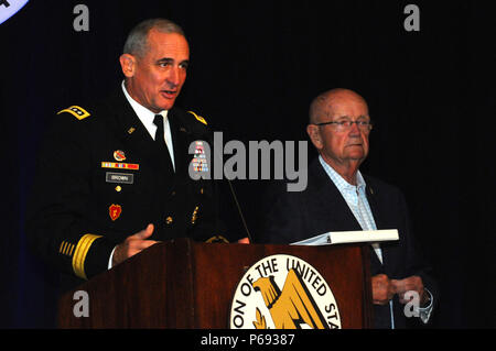 Gen. Robert B. Brown (left) honors Association of the United States Army President, retired U.S. Army Gen. Gordon R. Sullivan, for his 56 years of public service, which include over three decades of active duty service in the Army. LANPAC 2016 will be Sullivan's last symposium as he prepares to step down as AUSA President. (U.S. Army photo by Staff Sgt. Chris McCullough) - Stock Photo