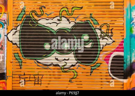 London Waterloo Leake Street graffiti letters DOG on cloud on orange roller shutter - Stock Photo