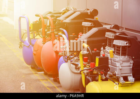 Many new air compressors pressure pumps close up photo . - Stock Photo