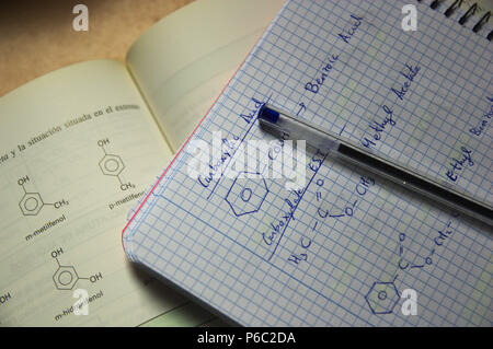 formulas of organic chemistry in a student's class notebook. - Stock Photo
