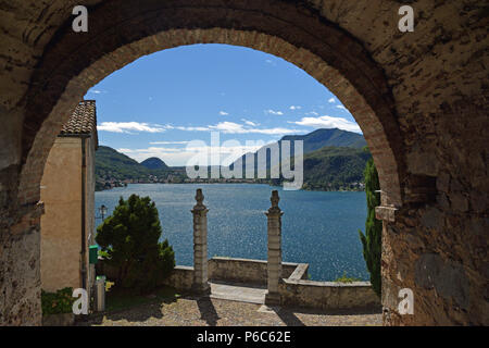 Arch view of lake in Lugano - Stock Photo