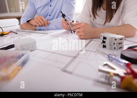 Two Architect Working With Work Tools Over Blueprint - Stock Photo