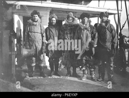 """. English: Dog sledders ('Mushers'), five men in arctic dress, ca. 1910 . English: Caption on image: Mushers, Alaska PH Coll 247.343 Someone who drives, or 'mushes', a dog team is known as a musher. The word probably comes from the French word 'marcher', which means 'to walk'. Subjects (LCTGM): Fur garments; Clothing & dress--Alaska; Men--Alaska Subjects (LCSH): Mushers--Clothing--Alaska; Cold weather clothing--Alaska  . circa 1910 39 Dog sledders (""""Mushers""""), five men in arctic dress, ca 1910 (THWAITES 308) - Stock Photo"""