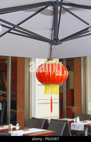 Traditional red chinese lantern in oriental restaurant - Stock Photo