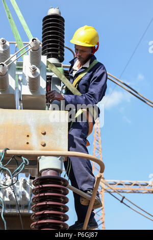 Johannesburg, South Africa, 04/11/2012, Electricians working on high voltage power lines. Highly skilled workmen servicing the electricity grid - Stock Photo