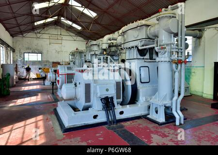Industrial air compressors in the compressor house,Geevor tin mine museum,Pendeen,West Penwith,Cornwall,England,UK - Stock Photo