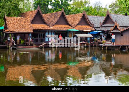 Laem Chabang, Thailand -- March 16, 2016. Tourists explore Thai water markets. - Stock Photo