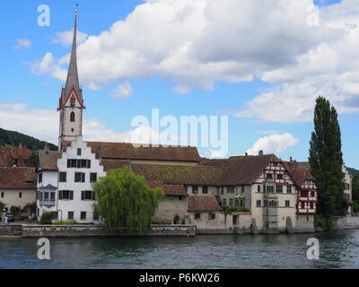 View of St. George's Abbey at Rhine River at european STEIN am RHEIN town in SWITZERLAND - Stock Photo