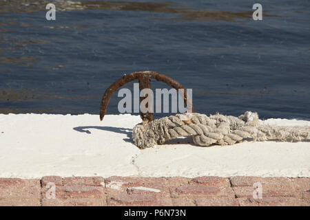 Tiny old anchor with rope, Telendos, Kalymnos, Greece - Stock Photo