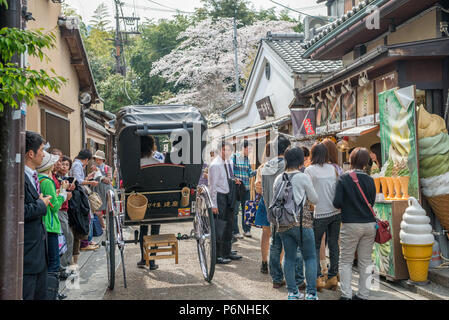 Japanese tourists explore Arashiyama in the outskirts of Kyoto, Japan. - Stock Photo