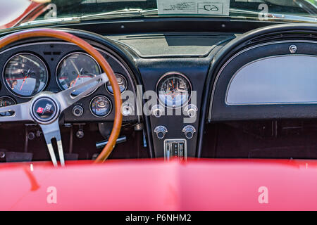 Shallow depth of field closeup of the cockpit and interior on a 1966 Chevrolet Corvette. - Stock Photo