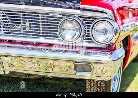 Shallow depth of field closeup of the front end details on a 1964 Ford Galaxie 500 XL convertible. - Stock Photo