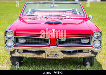 shallow depth of field closeup of the front end on a 1966 Pontiac Tempest convertible. - Stock Photo