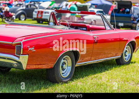 shallow depth of field closeup of the passenger side on a 1966 Pontiac Tempest convertible. - Stock Photo