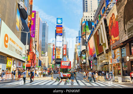 New York, USA- August 14, 2017 :  Times Square-central and main square of New York. Street, cars, people and tourists on it. - Stock Photo