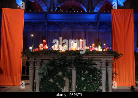 Basel Cathedral Minster. European Youth meeting of Taize in Basel.  Midday prayer. Church candles.  Switzerland. - Stock Photo