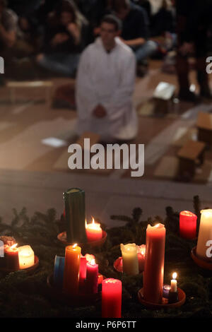 Basel Cathedral Minster. European Youth meeting of Taize in Basel.  Pilgrims at midday prayer.  Switzerland. - Stock Photo