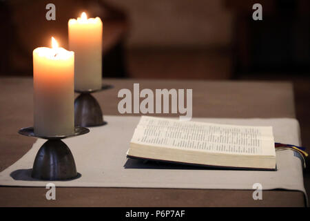Theodorskirche.  Bible and church candles on altar.  Basel. Switzerland. - Stock Photo