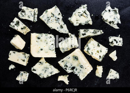 Danish blue cheese on dark background. Top view - Stock Photo