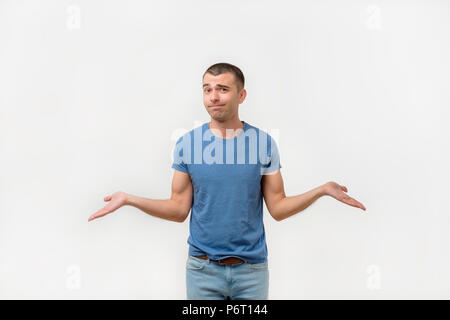 Closeup portrait young man shrugging shoulders. I don't know concept - Stock Photo