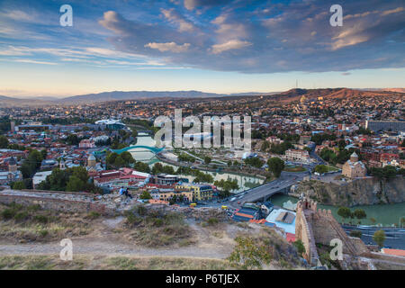 Georgia, Tbilisi, View from Narikala Fortress of Tbilisi looking towards Metekhi bridge and Church, Peace bridge and the Public Service Building, on the right is the Rike Park Theater and Exhibition Hall - Stock Photo