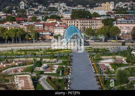 Georgia, Tbilisi, View of Peace bridge and Rike Park - Stock Photo
