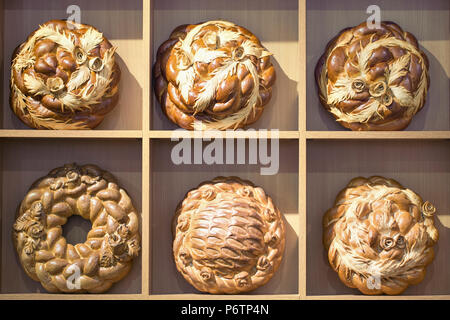 Kalaches. Traditional Ukrainian several different baked goods on a wooden stand, toned background image - Stock Photo