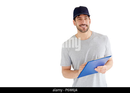 Portrait of handsome young man standing at isolated white background. Smiling carrying man wearing baseball cap and holding clipboard in his hand. - Stock Photo
