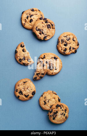 American cookies with chocolate chips on blue background. Top view. - Stock Photo