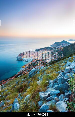 Dalmatia, Croatia, Dubrovnik. Sunest overDubrovnik old town from the hills above Dubrovnik - Stock Photo