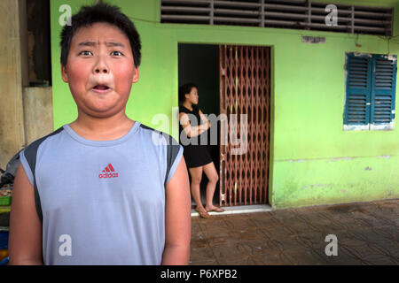 Young guy making funny face in Can Tho , Vietnam - Stock Photo